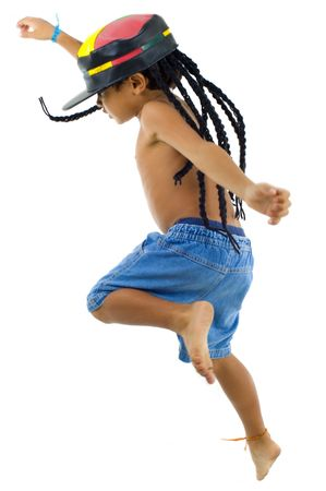 niños bailando: Chico de reggae - niño con sombrero de rastafari. Foto de archivo