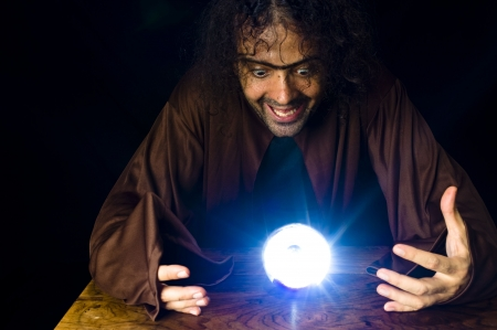 Wizard and his Crystal Ball - Waiting for your Future . Stock Photo - 6254675