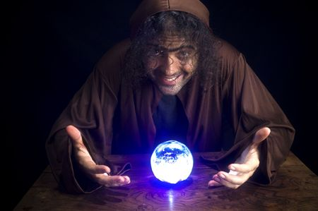 Wizard and his Crystal Ball - Waiting for your Future . Stock Photo - 6254673