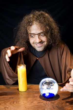 Wizard and his Crystal Ball - Waiting for your Future . Stock Photo - 6254684