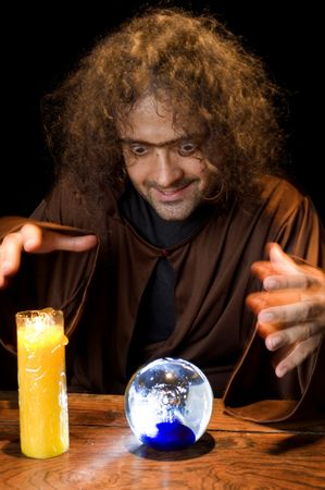 Wizard and his Crystal Ball - Waiting for your Future . Stock Photo - 6254679