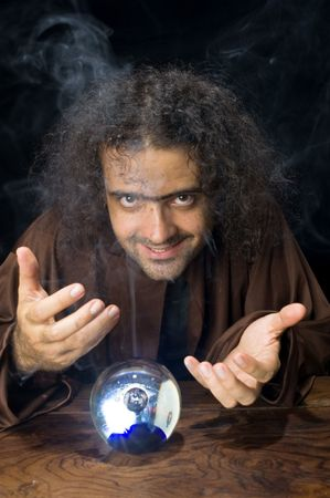 Wizard and his Crystal Ball - Waiting for your Future . Stock Photo - 6254676