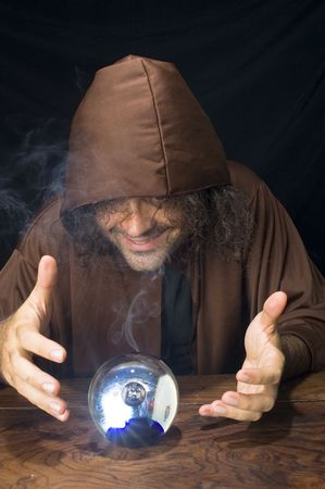 Wizard and his Crystal Ball - Waiting for your Future . Stock Photo - 6254683
