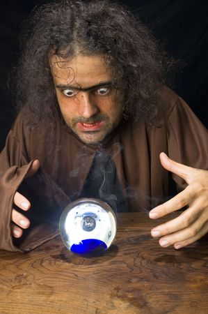 Wizard and his Crystal Ball - Waiting for your Future . Stock Photo - 6254685