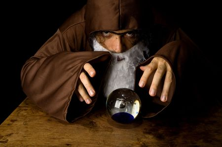 Wizard and his Crystal Ball - Waiting for your Future . Stock Photo - 6254726