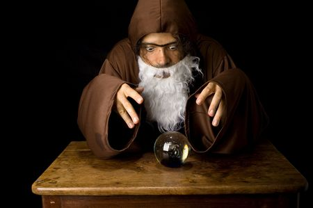 Wizard and his Crystal Ball - Waiting for your Future . Stock Photo - 6254694