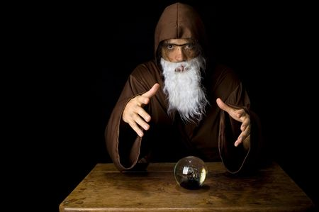 Wizard and his Crystal Ball - Waiting for your Future . Stock Photo - 6254690