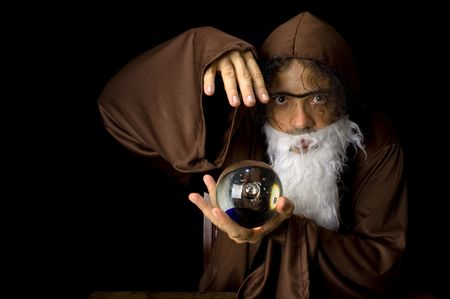 Wizard and his Crystal Ball - Waiting for your Future . Stock Photo - 6254692