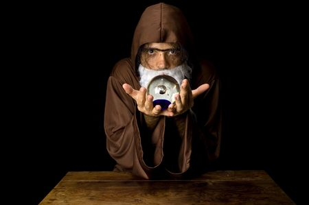 Wizard and his Crystal Ball - Waiting for your Future . Stock Photo - 6254687