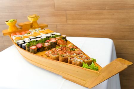 Traditional Japanese food - sushi and rolls in the wood boat. photo