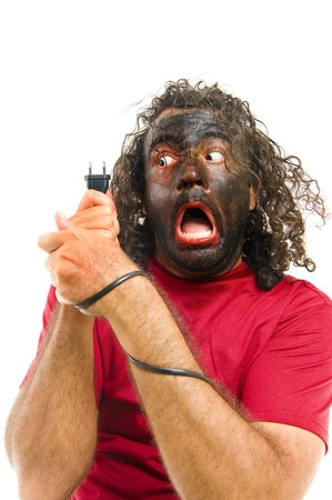 scary man screaming after receiving an shock during repair. Stock Photo - 7076175