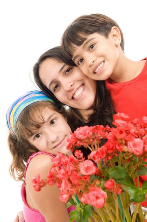 joy of giving: Mother receiving a flower from her kids .