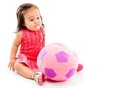 childishness: Baby bored with the plush doll on white background .