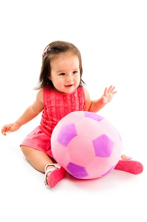 childishness: Happy Asian baby smilling with a plush ball .