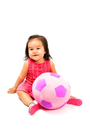 smilling: Happy baby smilling with a plush ball . Stock Photo