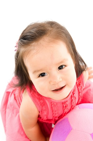 Cute asian baby smilling holding a plush ball . Stock Photo