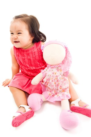Happy baby holding a doll on white background . Stock Photo - 7734467
