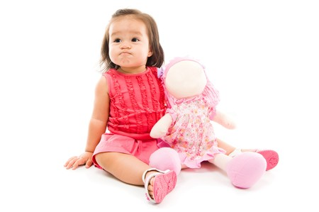 childishness: Angry Baby holding a doll on white backgroudn