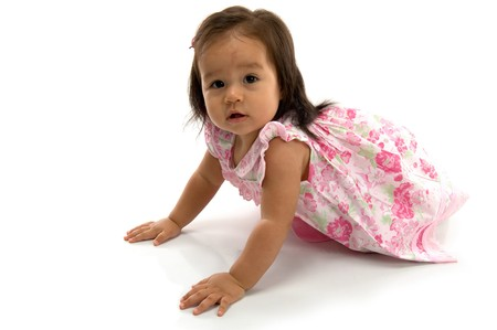 Beautiful Baby crawling on white background . photo