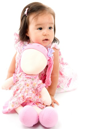 baby doll: Cute asian baby with a doll on white background . Stock Photo