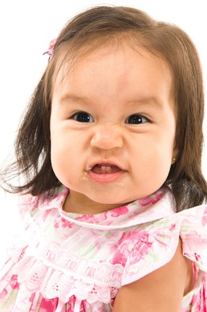 infants: portrait of baby with a very angry expression  Stock Photo