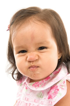 Baby making a funny face after eat . Stock Photo