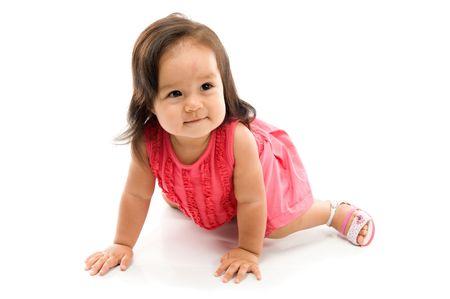Happy asian baby crawling on white background . photo