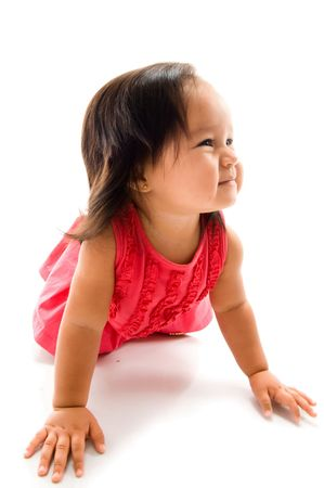 Happy asian baby crawling on white background . photo