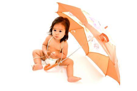 Cute Asian Babya with a orange Umbrella . photo
