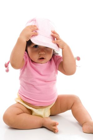 Cute Asian baby using a hat on white background . photo