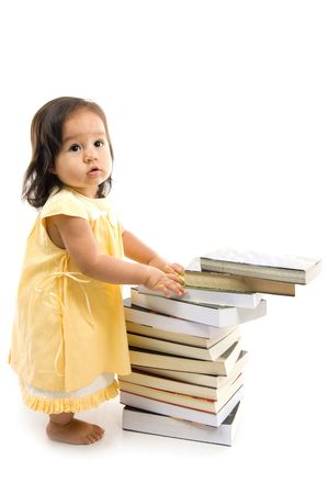 baby sit: Happy Baby with a pile of books .