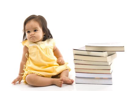 Angry Baby with a pile of books .
