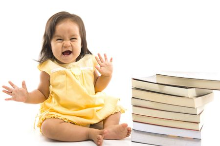 Happy Baby with a pile of books .  photo