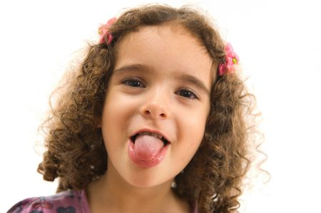 Portrait of a child showing his tongue . photo