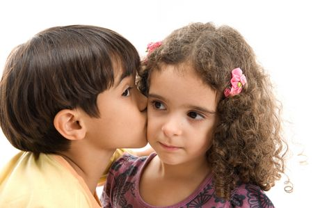 kisses: Young boy kissing a girl in the face .