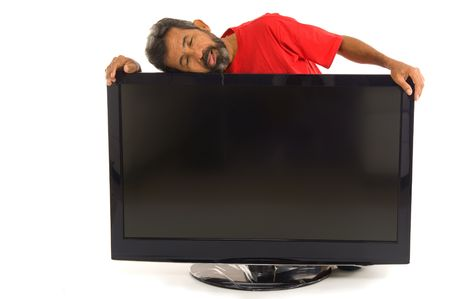 whacked: Tired man hugging the tv on white background .