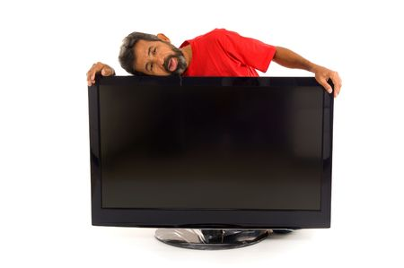 Tired man hugging the tv on white background . photo