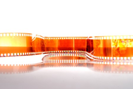 Film strip in front of a white background . Stock Photo