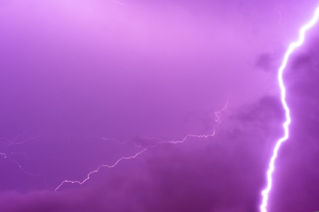 Thunder storm and power Lightning over sky . photo