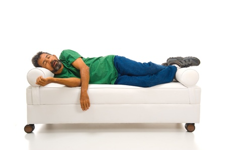 lying on couch: tired adult man sleeping in the sofa . Stock Photo