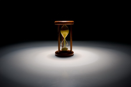 Vintage hourglass with yellow sand . Stock Photo