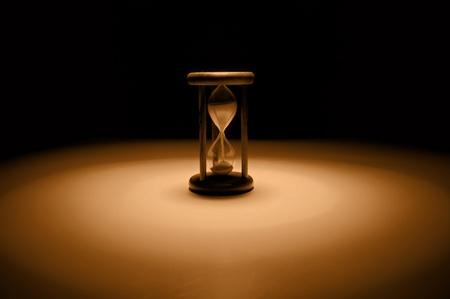 Vintage hourglass on sephia tones . photo