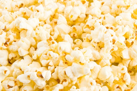 popped: Close up of Buttered Popcorn background .