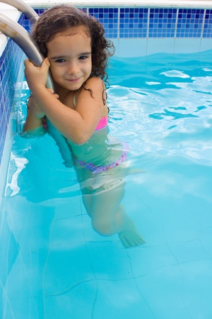 Cute and happy child in the pool . photo