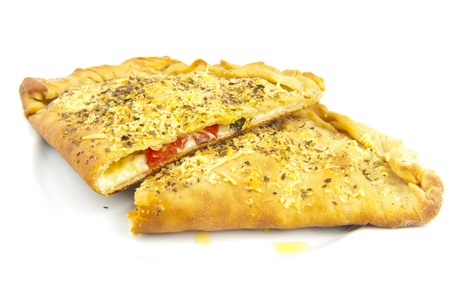 Delicious Calzone sliced in two parts . photo