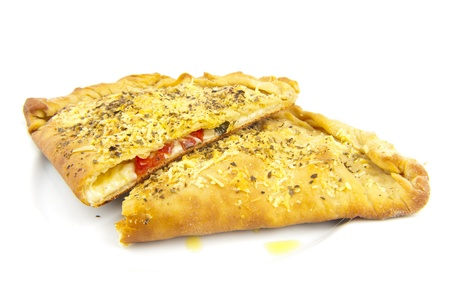 Delicious Calzone sliced in two parts .
