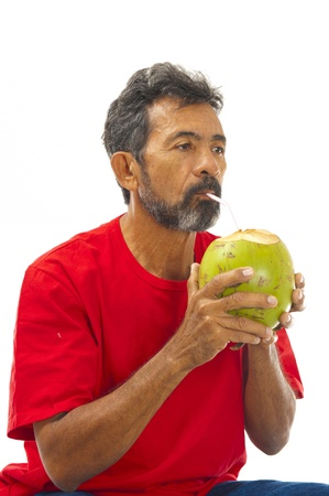 Man Drinking Coconut Water on white background . photo