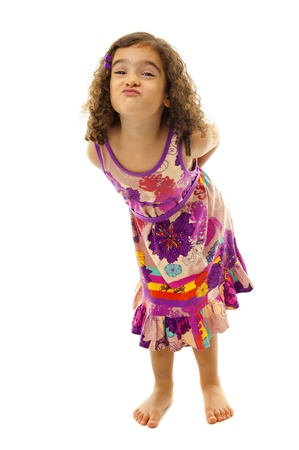 grimacing: Funny child girl grimacing on white background Stock Photo