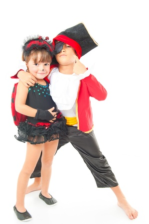 Beautiful children with costumes on white background . photo