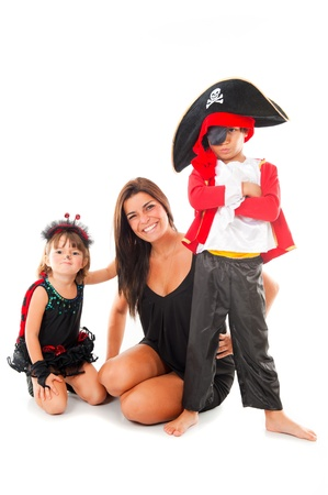 Woman with two children using costumes .